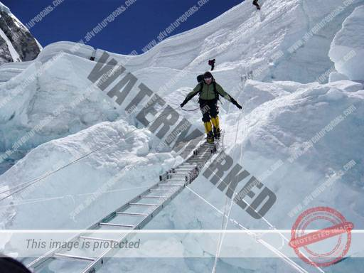 Moving on The Ladders in The Khumbu Icefall
