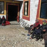 Our local porters and guide relaxing in sun after a hard day's work