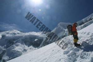 Upendra heading up to C2 with summit in background