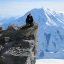 Climber-perched-at-the-edge-of-High-Camp-with-Foraker-in-the-background